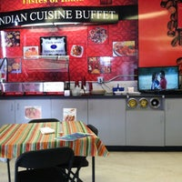 Photo taken at Circle 7 Indian Cuisine by Whitney P. on 6/24/2013