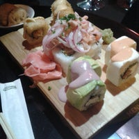 Photo taken at SUSHI CLUB by Nivia Andrea R. on 8/29/2014