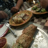 Photo taken at Ramunto's Brick Oven Pizza by Lacie S. on 9/13/2013