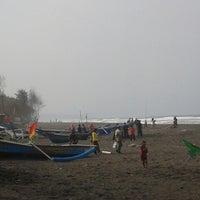 Photo taken at Pantai Kuwaru by Purwanto K. on 6/15/2014