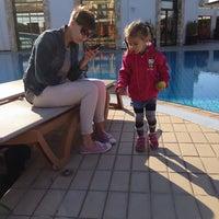 Photo taken at Atlantica Aeneas Resort Hotel pool by Valentin R. on 12/19/2013
