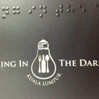 Photo taken at Dining In The Dark KL by Kc L. on 7/18/2013