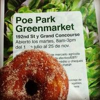 Photo taken at Poe Park Greenmarket by Lau R. on 7/1/2014
