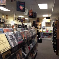 Photo taken at Groovy Records by Oscar C. on 7/12/2014