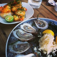 Photo taken at Cool City Oyster Yard by Angel T. on 7/20/2013
