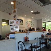 Photo taken at Lotus Restaurant by Caroline C. on 6/13/2014