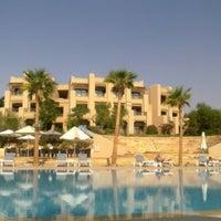 Photo taken at Dead Sea Beach (Holiday Inn Resort) by Sheghaf K. on 3/29/2013