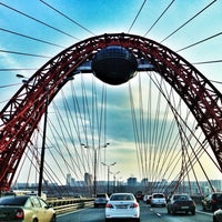 Photo taken at Zhivopisny Bridge by Ta S. on 4/20/2013