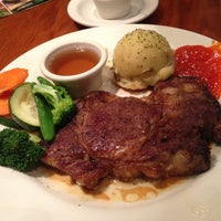 Photo taken at Outback Steakhouse by Dewi P. on 5/5/2013