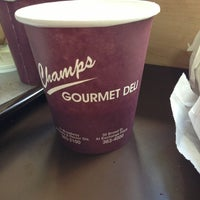 Photo taken at Champs Gourmet Deli by Gogi M. on 3/14/2013