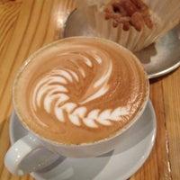 Photo taken at Sola Coffee Café by Angela K. on 3/21/2013