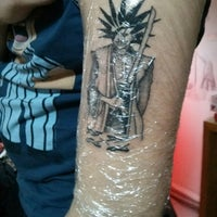 Photo taken at Tugay Tattoo by Gokhan T. on 2/15/2014