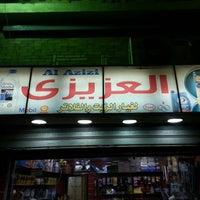 Photo taken at Al Azizi by Mohamed Y. on 6/20/2013