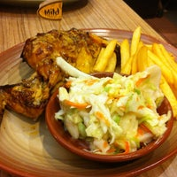 Photo taken at Nando's by May🎀 on 12/21/2012