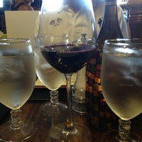Photo taken at Liquid Assets Bistro and Package Goods by Jenna A. on 7/4/2013