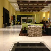 Photo taken at Holiday Inn by Clau A. on 6/30/2013