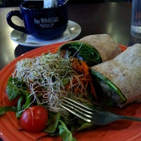 Photo taken at One World Café by Mieko R. on 11/14/2012