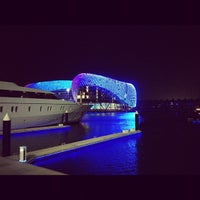 Photo taken at Yas Marina & Yacht Club by Çağkan Y. on 7/20/2013