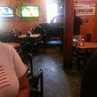 Photo taken at Satisfaction Restaurant & Bar by Tara W. on 7/23/2013