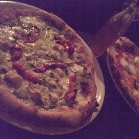 Photo taken at Cornuto Pizzeria by Ullas U. on 3/4/2014