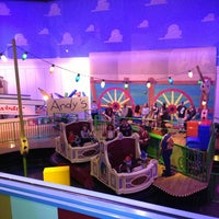 Photo taken at Toy Story Mania! by Liliana F. on 12/31/2012