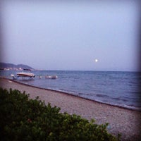 Photo taken at Gullac Beach by Tülay G. on 8/28/2013
