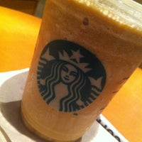 Photo taken at Starbucks by Esra M. on 6/6/2013