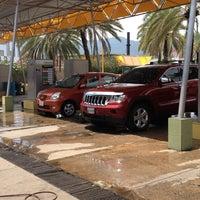 Photo taken at Autolavado La Bandera by Jay R. on 9/26/2013