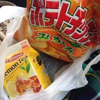 Photo taken at FamilyMart by Akiko K. on 1/5/2015