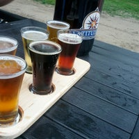 Photo taken at Latitude 42 Brewing Company by Montora T. on 8/6/2013