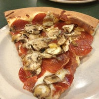 Photo taken at Woodstock's Pizza by Katy D. on 3/21/2013