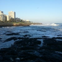 Photo taken at Sea Point Beach Promenade by Leo L. on 6/15/2013