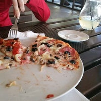 Photo taken at Puffy Pizza by Marius P. on 6/2/2015