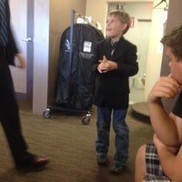 Photo taken at Men's Wearhouse by Troy B. on 7/27/2014