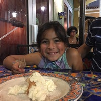 Photo taken at Tarantella Ristorante & Pizzeria by Mayra B. on 5/9/2015