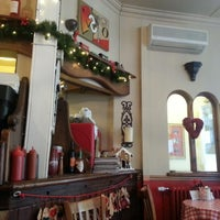 Photo taken at Cafe Retro by Gary C T. on 12/18/2012