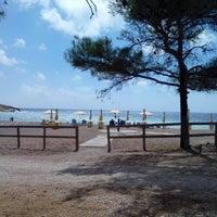 Photo taken at Fourni Beach by Vera K. on 9/18/2013