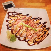 Photo taken at Tsunami Japanese Steakhouse and Sushi Bar by Maria Jose C. on 5/1/2013