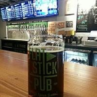 Photo taken at Flatstick Pub by Chris M. on 8/4/2014