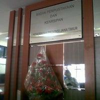 Photo taken at Badan Perpustakaan dan Kearsipan Provinsi Jawa Timur by Richa B. on 5/9/2014