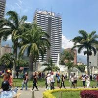 Photo taken at Plaza Venezuela by Gabriela F. on 4/7/2013