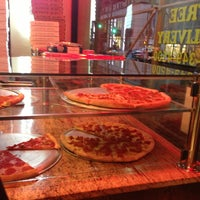 Photo taken at Masterpiece Italian Pizzeria by Adam G. on 4/15/2013