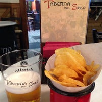 Photo taken at Taberna del Siglo by Amelia A. on 2/27/2014