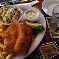 Photo taken at Durty Nelly's Irish Pub & Restaurant by Alexander G. on 7/3/2013