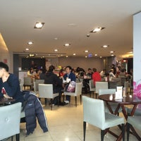 Photo taken at Xianjufu Café by Hongjung K. on 1/25/2015