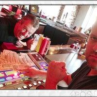 Photo taken at Grind Burger Bar & Lounge by Tim B. on 3/25/2013