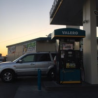 Photo taken at Valero by Adam R. on 4/19/2016