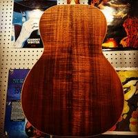 Photo taken at Guitars United by Guitars U. on 6/25/2015