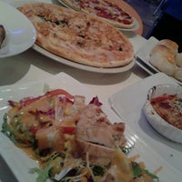 Photo taken at Izzi Pizza by Kemas F. on 8/5/2013