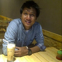 Photo taken at Martubung Coffee Club by Yogie P. on 8/2/2013